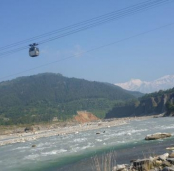 It is a bicable bidirectional type of ropeway technology operates under motor power design and builds by the engineers of Nepal using locally available materials. The system is installed as prototype for human transportation connecting Kotre, Tanahun and Punditar, Kaski over Seti River having 520m with 25m level difference. At that section, numerous efforts of bridge construction was in vain due to technical infeasibility. So ropeway technology for river crossing is the best at such long span. The technology is also economical considering construction as well as operation cost for the span greater than 450 meters